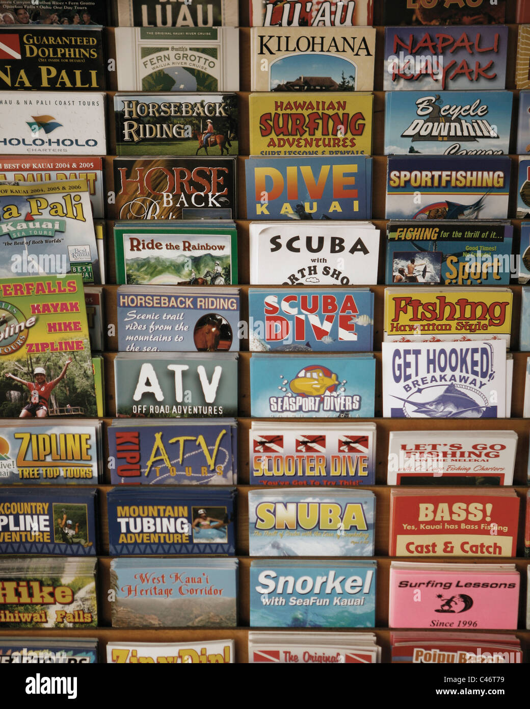 Tourist activity fliers on display in Hawaii. - Stock Image
