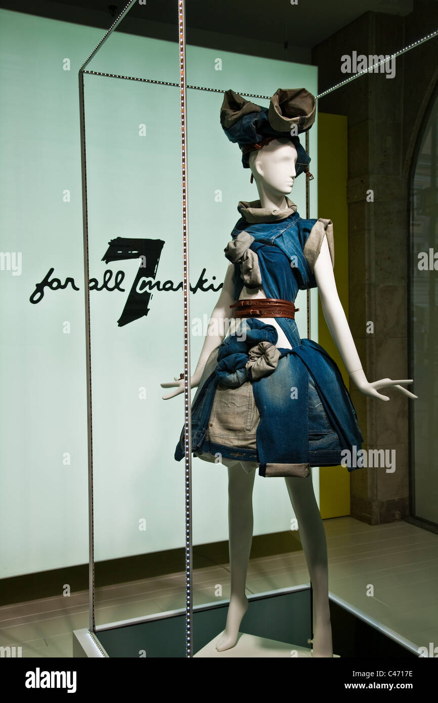 Mannequin dressed in a variety of blue jeans illustrating versatility of design, Munich, Germany - Stock Image