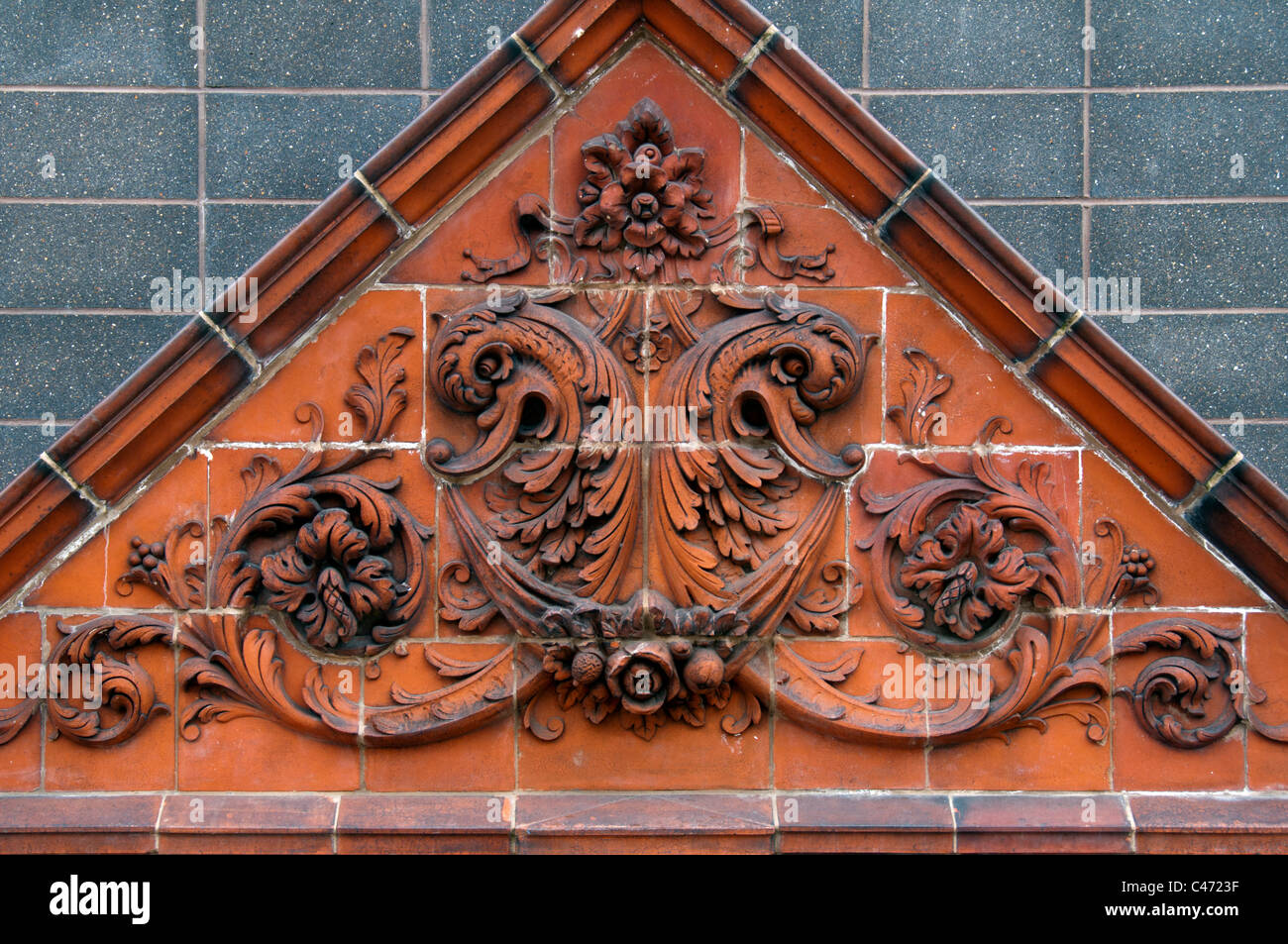 Terracotta pediment from the demolished Wilson's hat factory, Crownpoint Shopping Park, Denton, Tameside, Manchester, - Stock Image