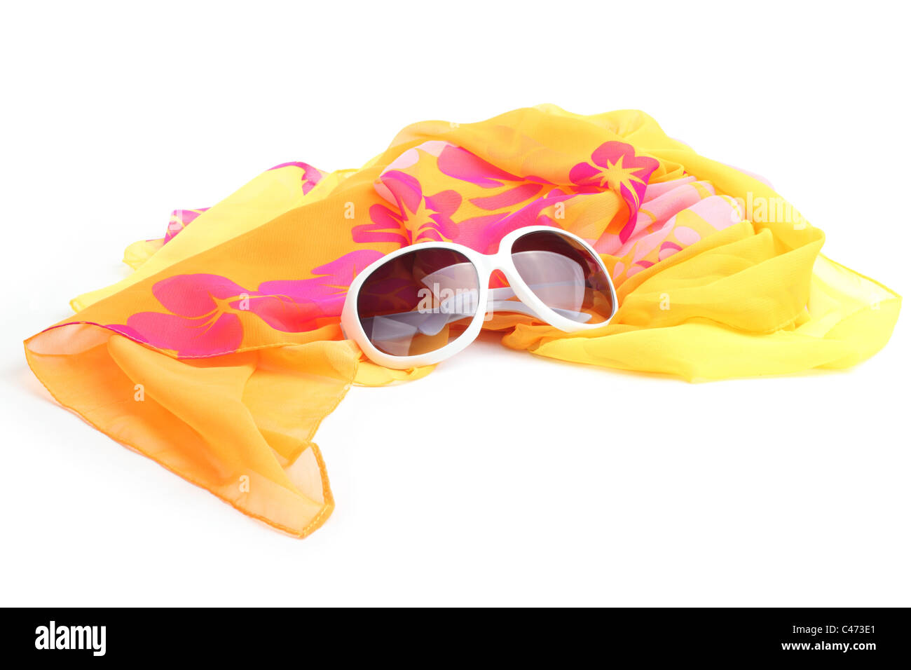 Beach accessories--Yellow shawl with sunglasses isolated on white background Stock Photo