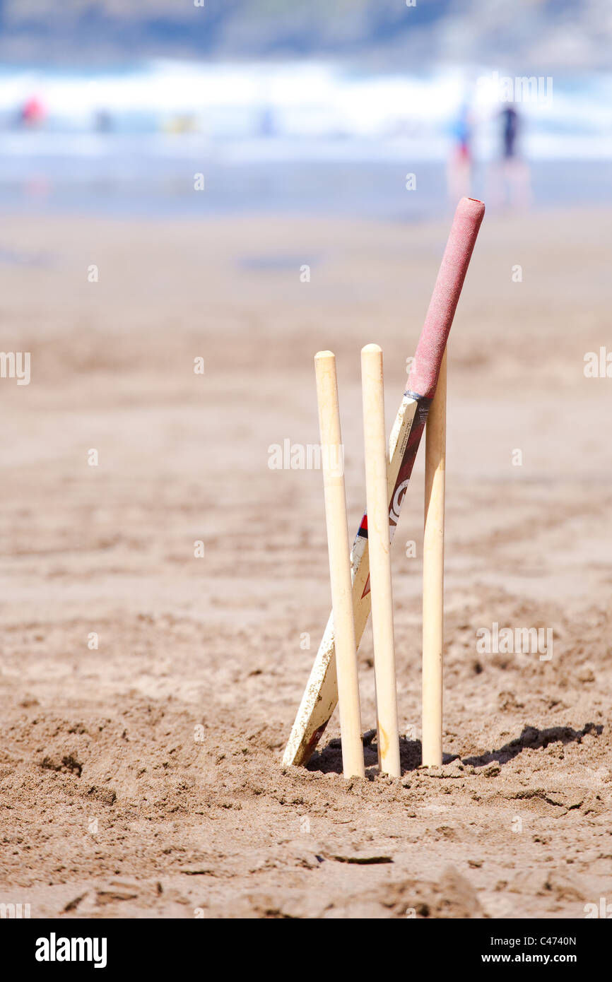 Cricket game on a beach in the UK - Stock Image