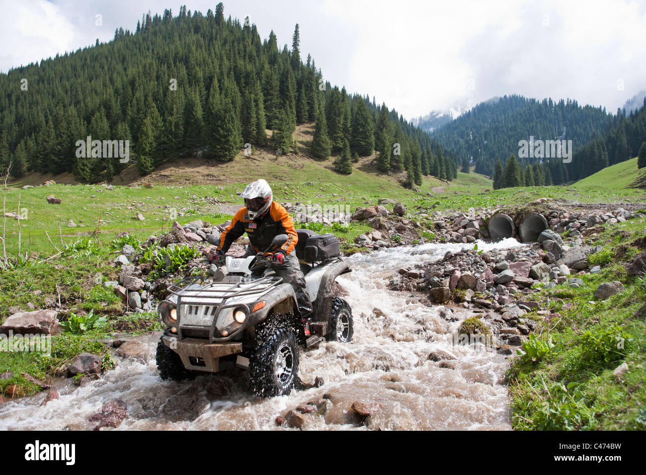 Kazakhstan. A motor-cyclist is in mountains - Stock Image