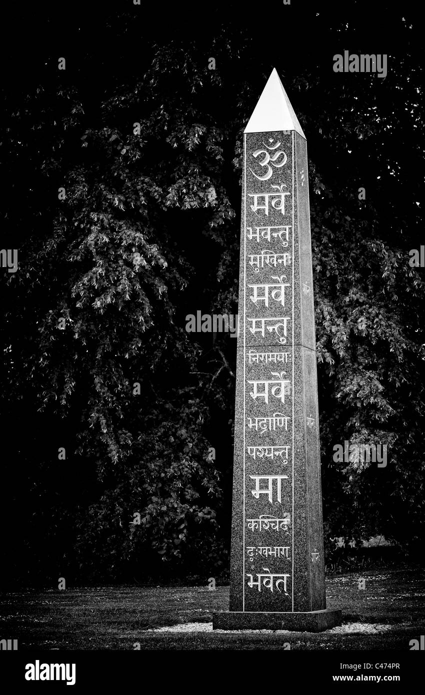Om and Sanskrit on the peace Obelisk at Waterperry gardens, Wheatley, Oxfordshire, UK. Monochrome - Stock Image