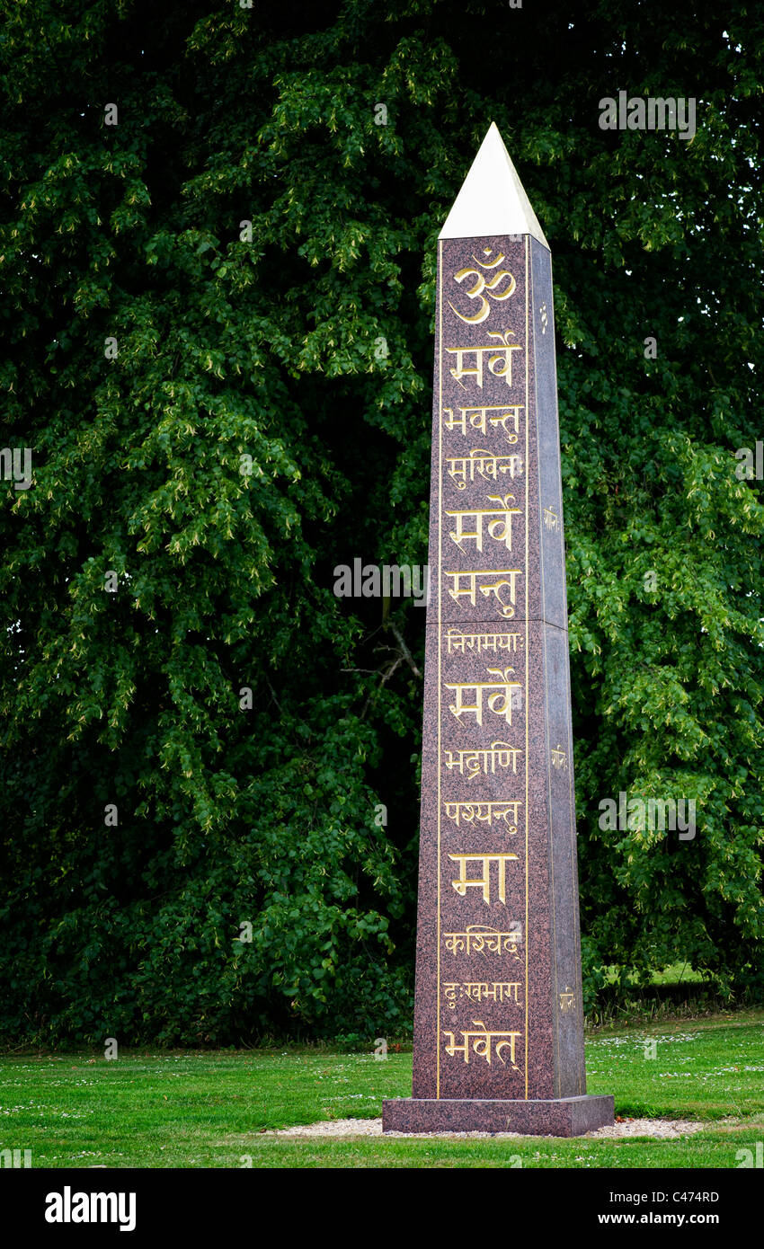 Om and Sanskrit on the peace Obelisk at Waterperry gardens, Wheatley, Oxfordshire. UK - Stock Image