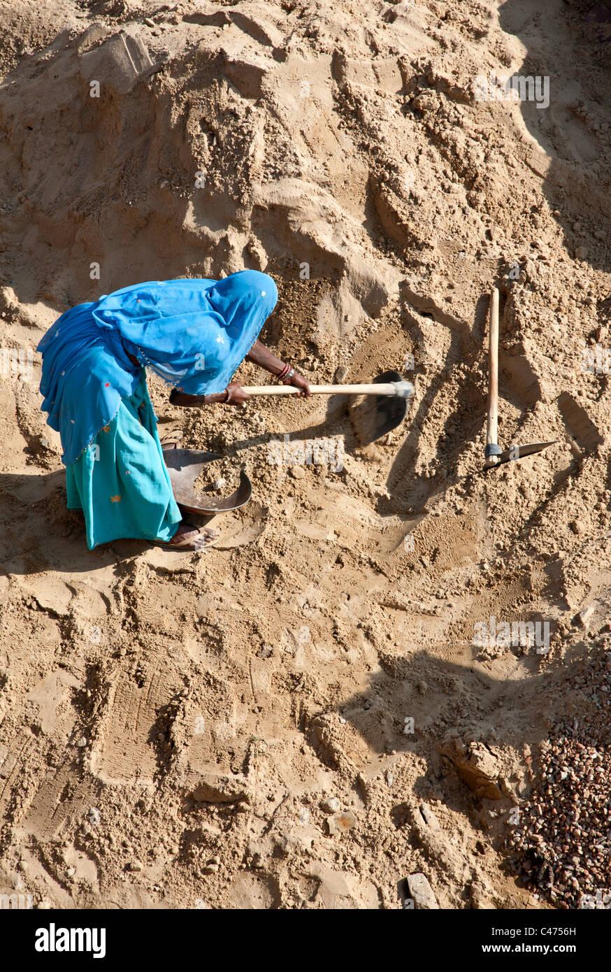 Indian woman working. Pushkar. Rajasthan. India - Stock Image