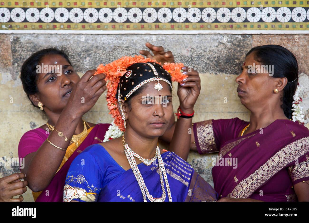 Women putting a traditional garland  to a bride. Madurai. Tamil Nadu. India - Stock Image