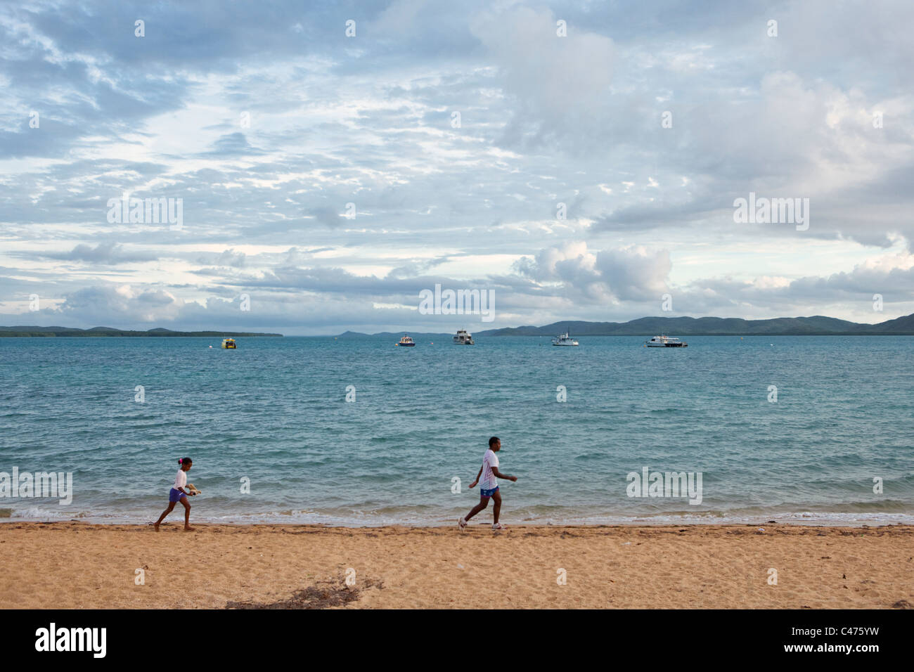 Locals walking along the beach on the Victoria Parade foreshore. Thursday Island, Torres Strait Islands, Queensland, - Stock Image
