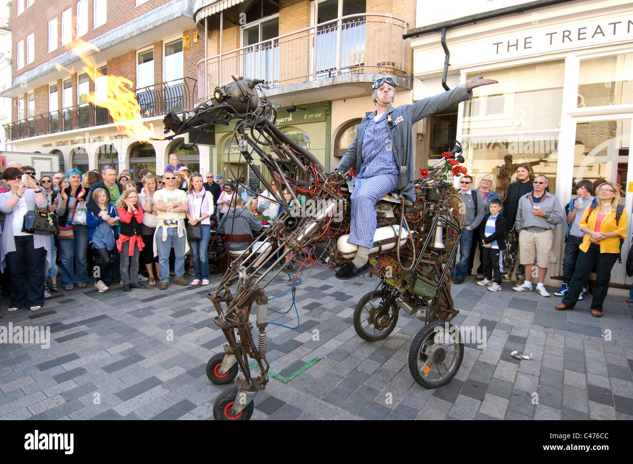 A street entertainer rides his fire breathing iron horse during the 2011 Brighton Festival Fringe - Stock Image