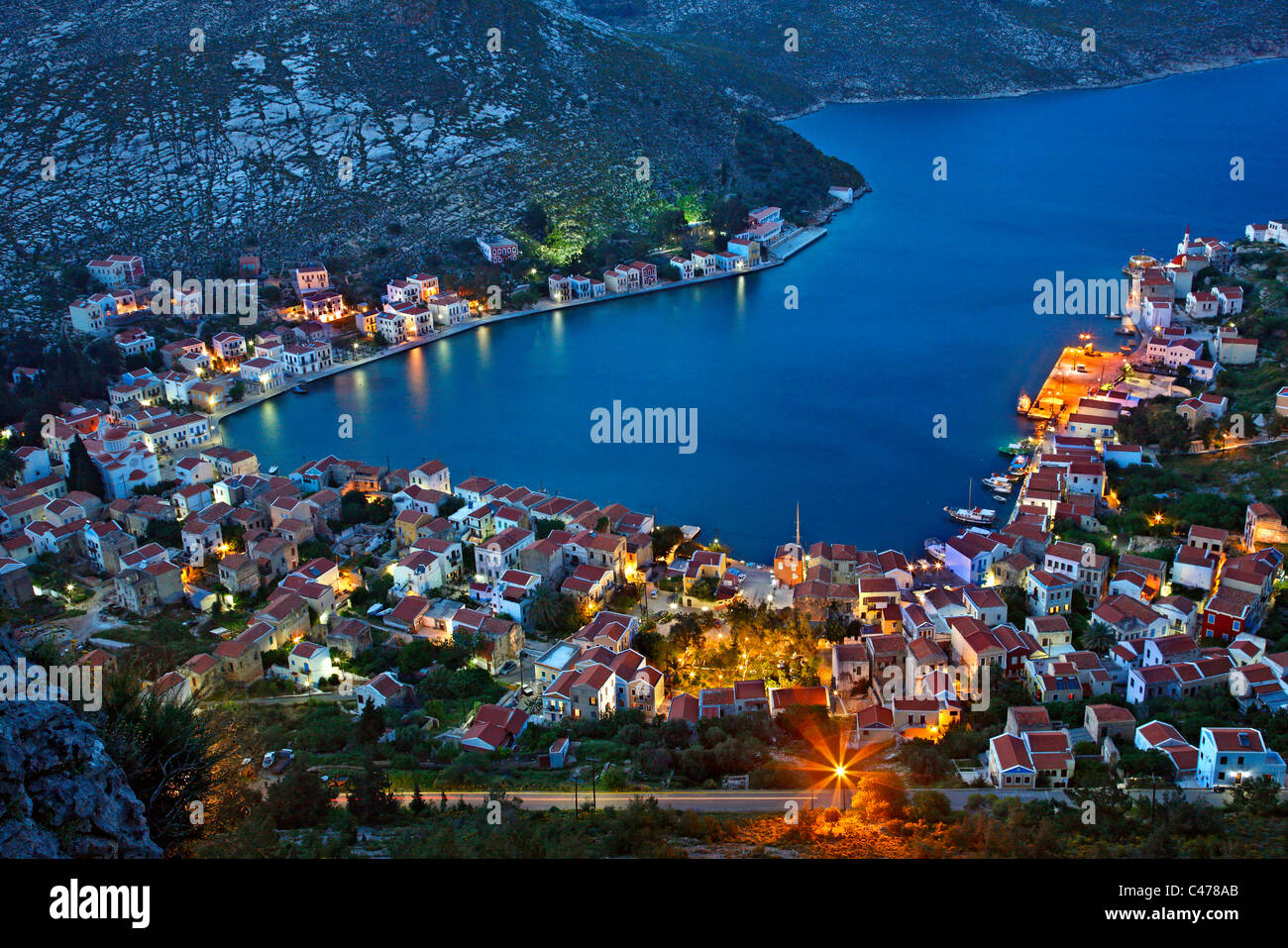 Panoramic view of the village and harbor of Kastellorizo island from the path that goes to Saint George Monastery. - Stock Image
