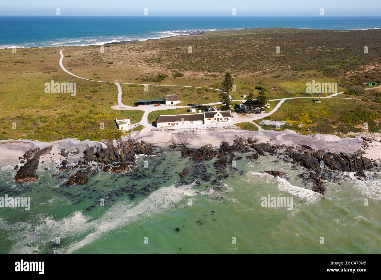 Aerial view of the old farmhouse at Bokbaai on the west coast north of Cape Town in South Africa. - Stock Image