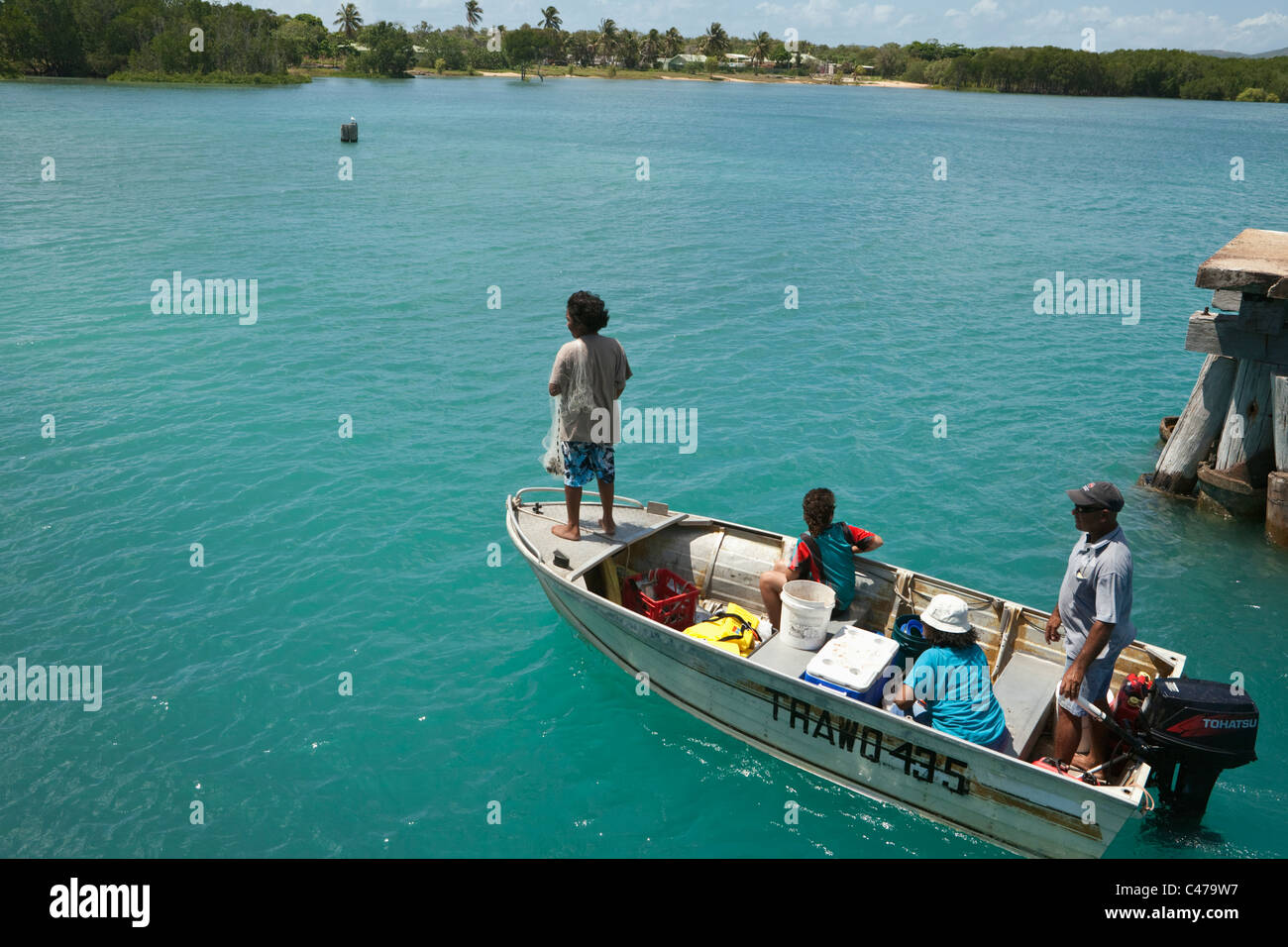 Locals fishing by dinghy at Horn Island, Torres Strait Islands, Queensland, Australia - Stock Image