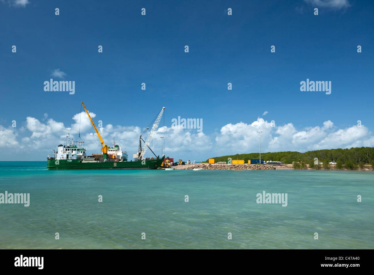 A cargo ship unloads cargo at the port. Horn Island, Torres Strait Islands, Queensland, Australia - Stock Image