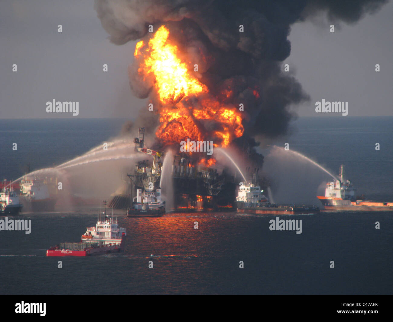 Fire boats battle an explosion at the off shore oil rig Deepwater Horizon - Stock Image