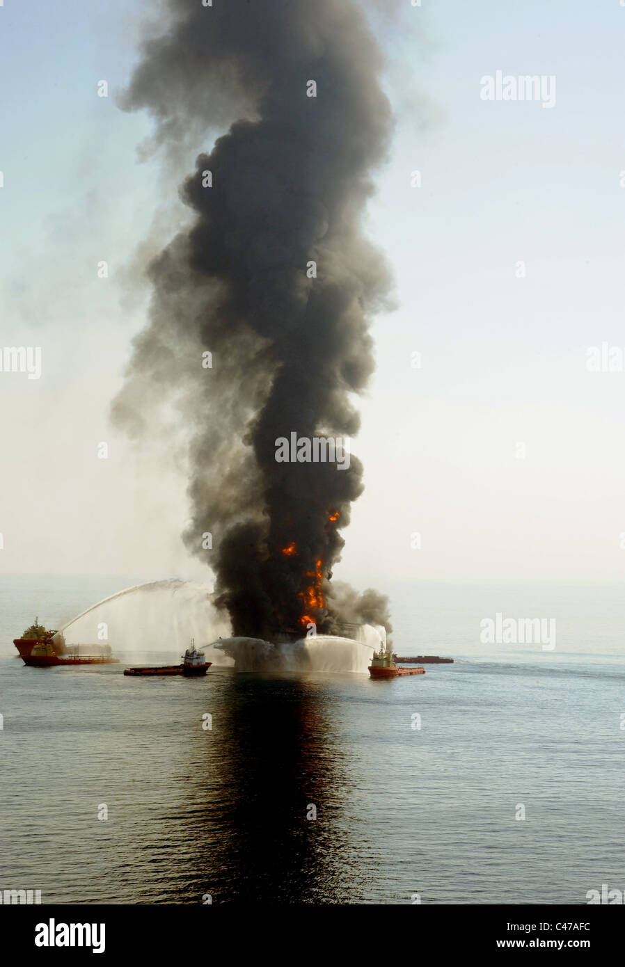 Fire boats battle an explosion at the off shore oil rig Deepwater Horizon in the Gulf of Mexico. - Stock Image