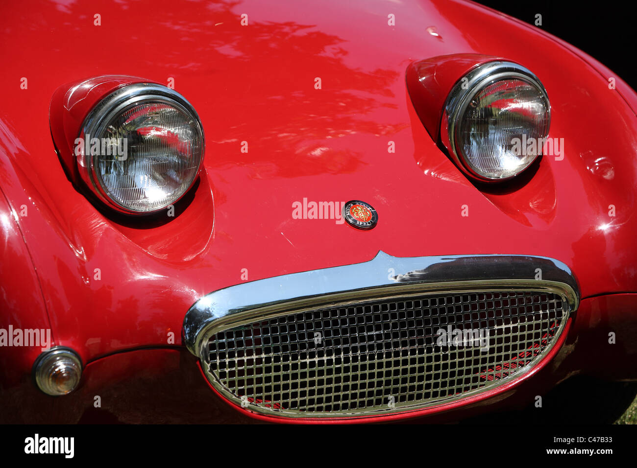 Bright red Austin Healey Sprite - Stock Image