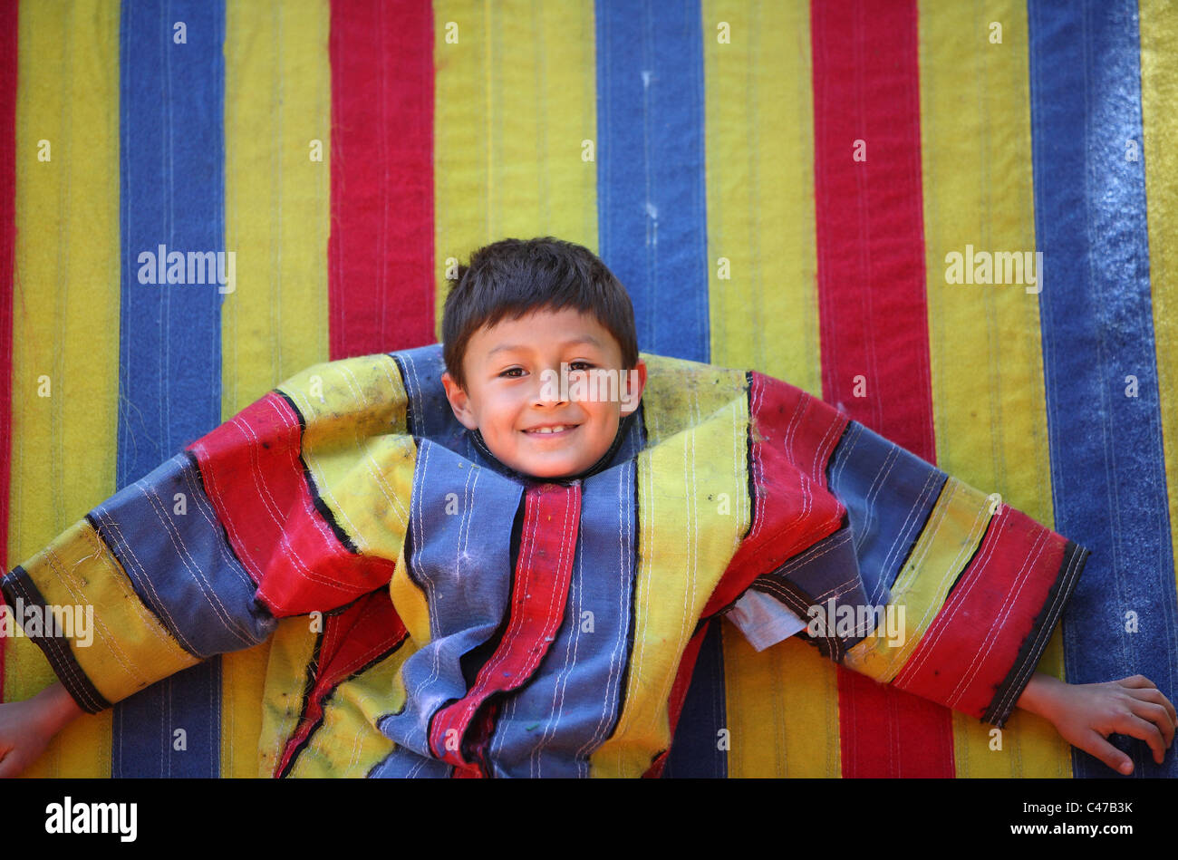 Young latino or Hispanic boy on velcro sticky wall Stock Photo