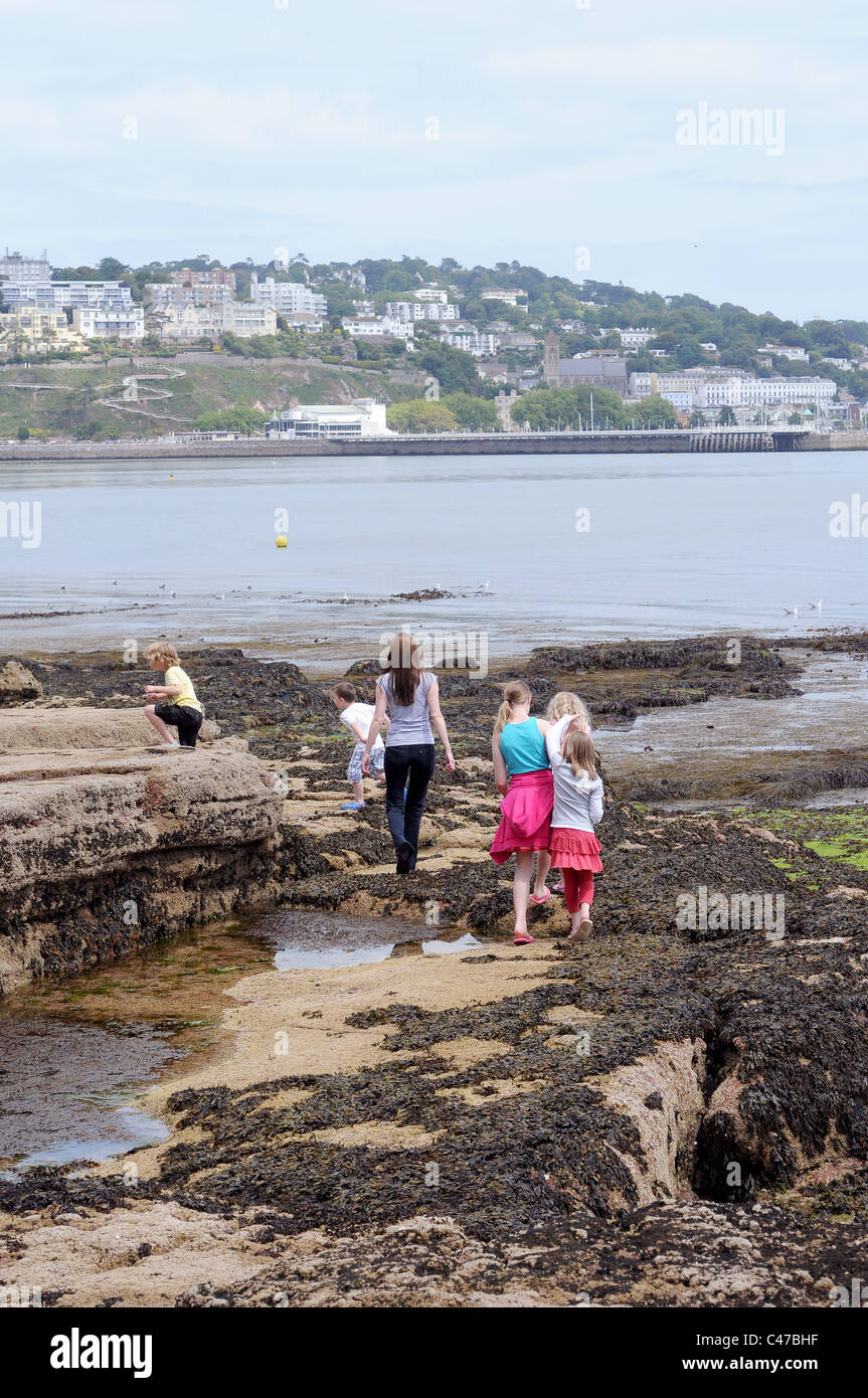With beautiful beaches at our doorstep a single mum with large family at the seaside at low tide iTorquay,Devon,family - Stock Image