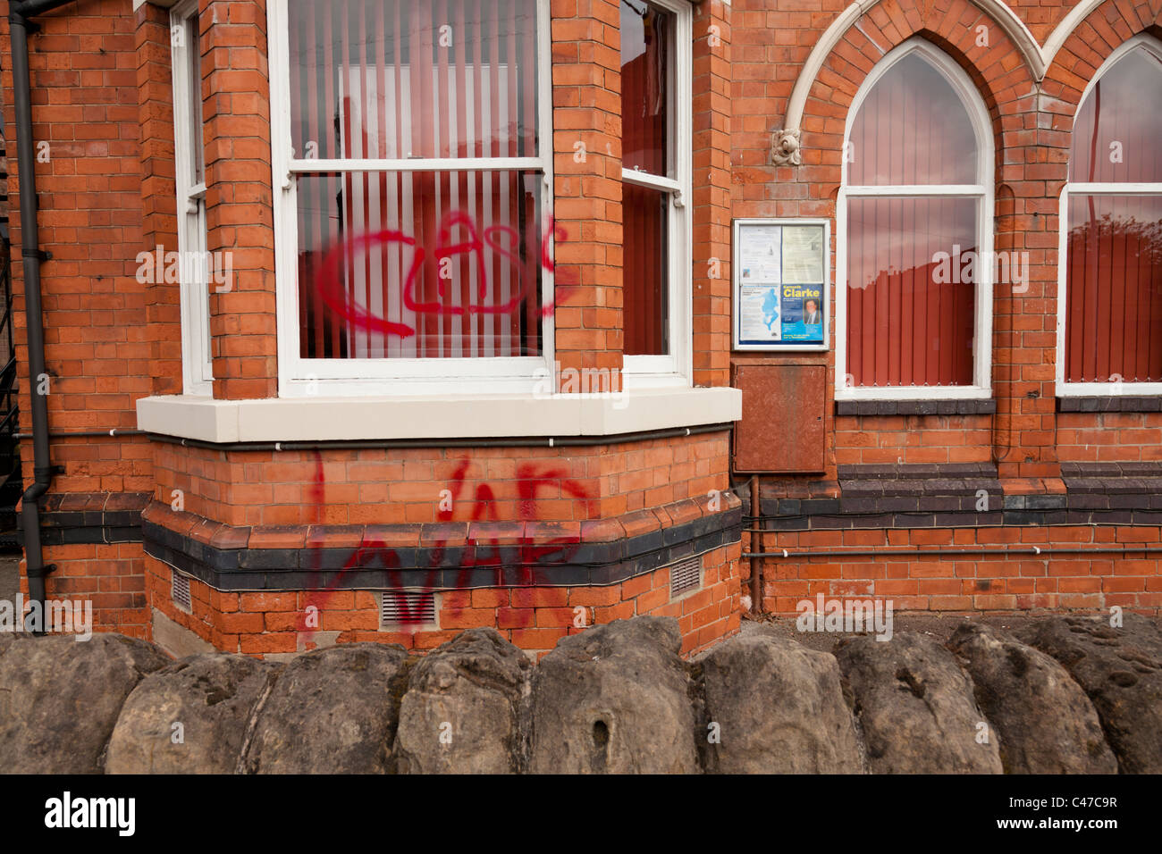 Rushcliffe Conservative Association Headquarters with political graffiti across the front of the building - Stock Image