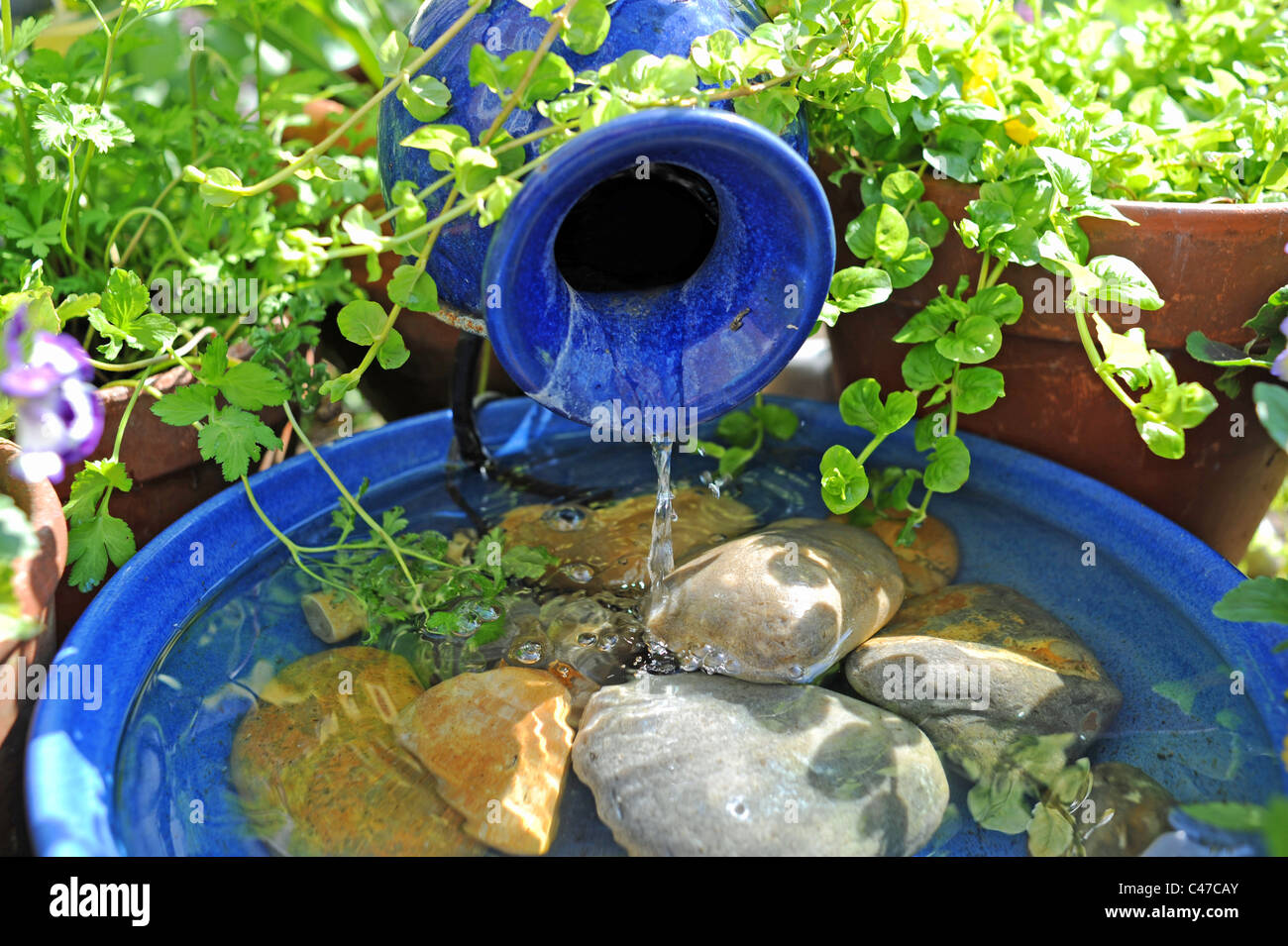 A Solar Powered Small Water Feature In British Garden