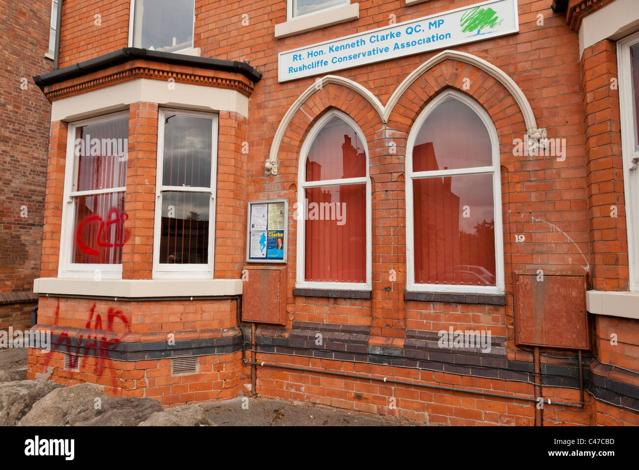 Anarchist Class War political graffiti across the front of the Rushcliffe Conservative Association Headquarters - Stock Image