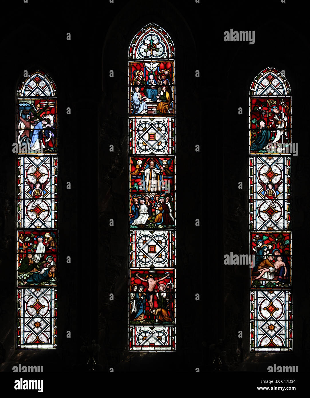 A stained glass window by Clayton and Bell depicting the Passion of Christ, St Nicholas's Church, Tackley, Oxfordshire - Stock Image