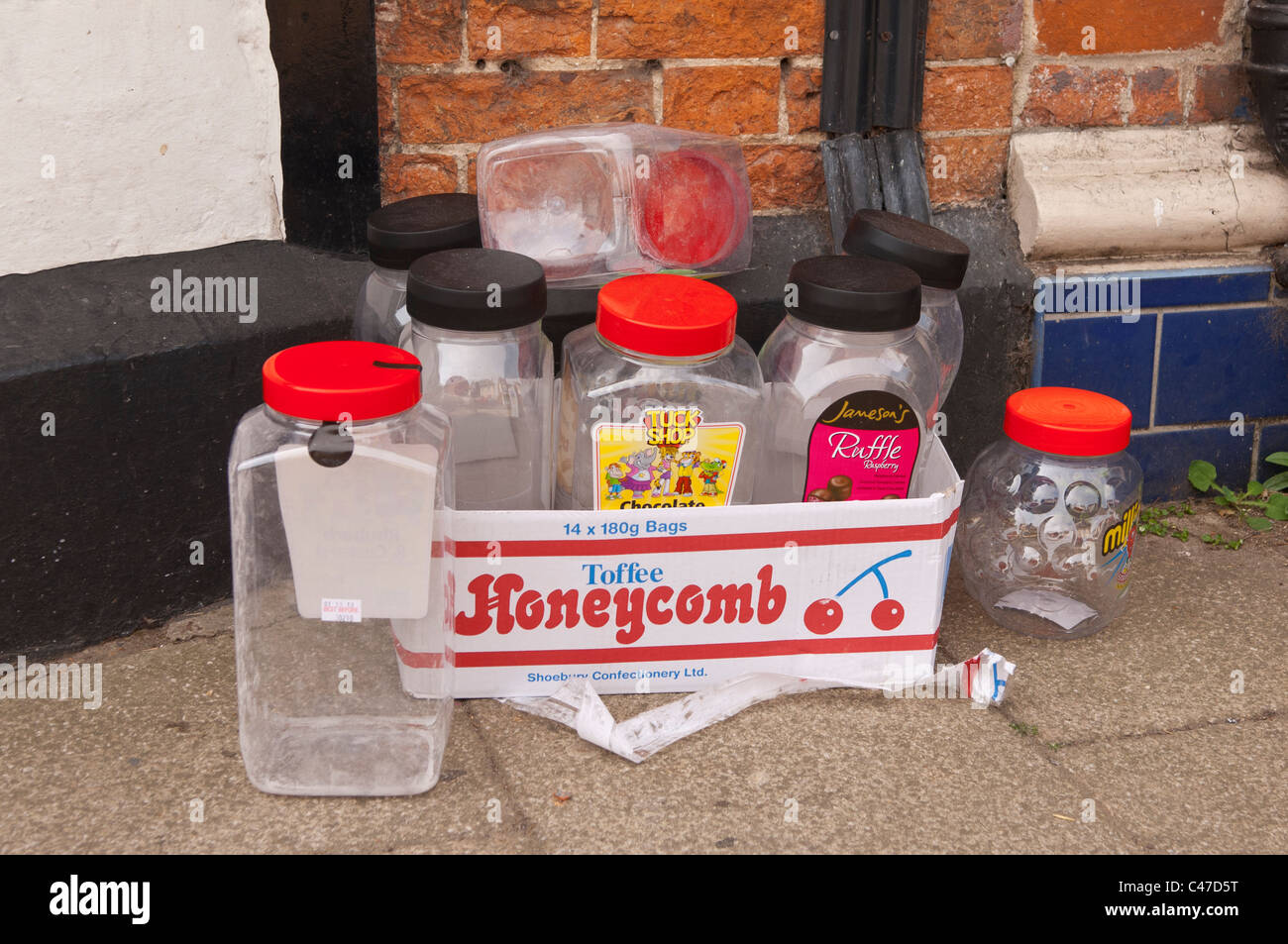 Old sweet jars being given away outside a Uk sweet shop - Stock Image