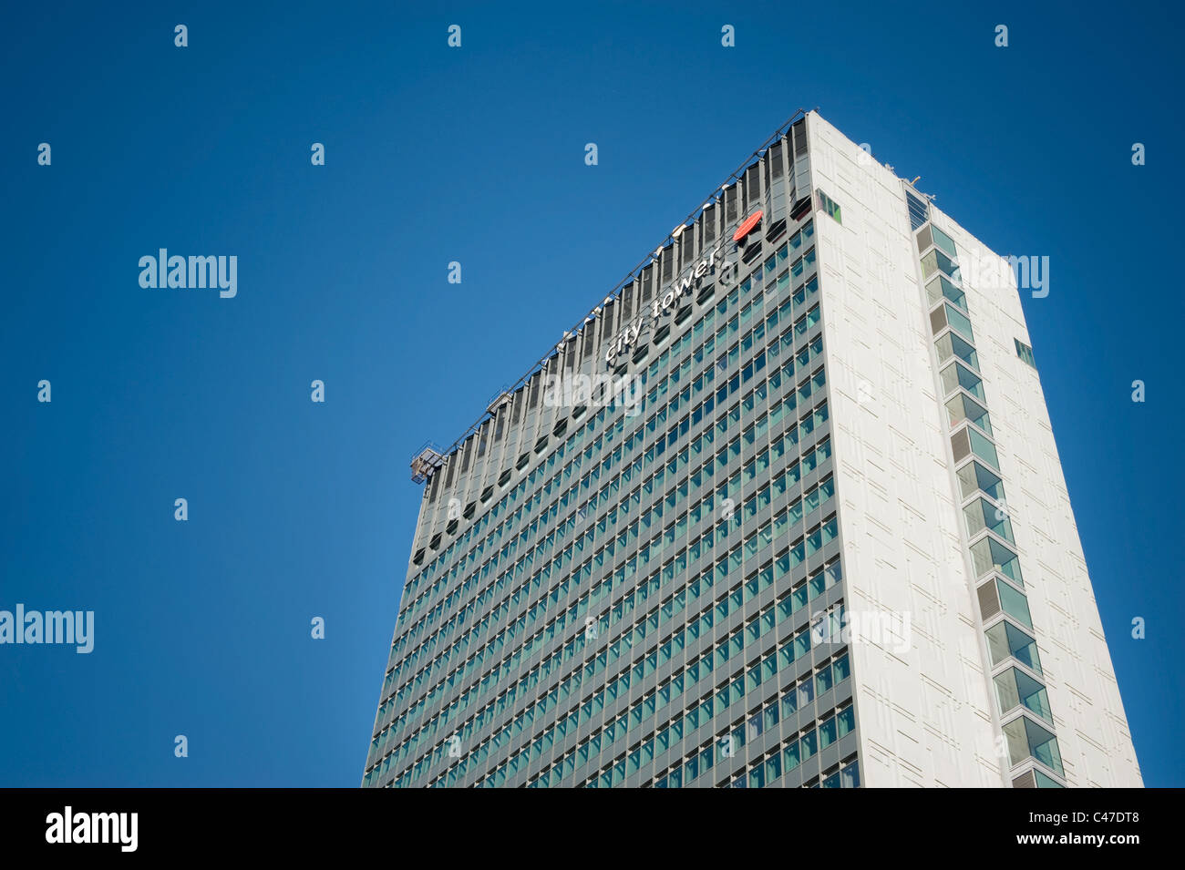City Tower Piccadilly, Manchester, shot against a clear blue sky. - Stock Image