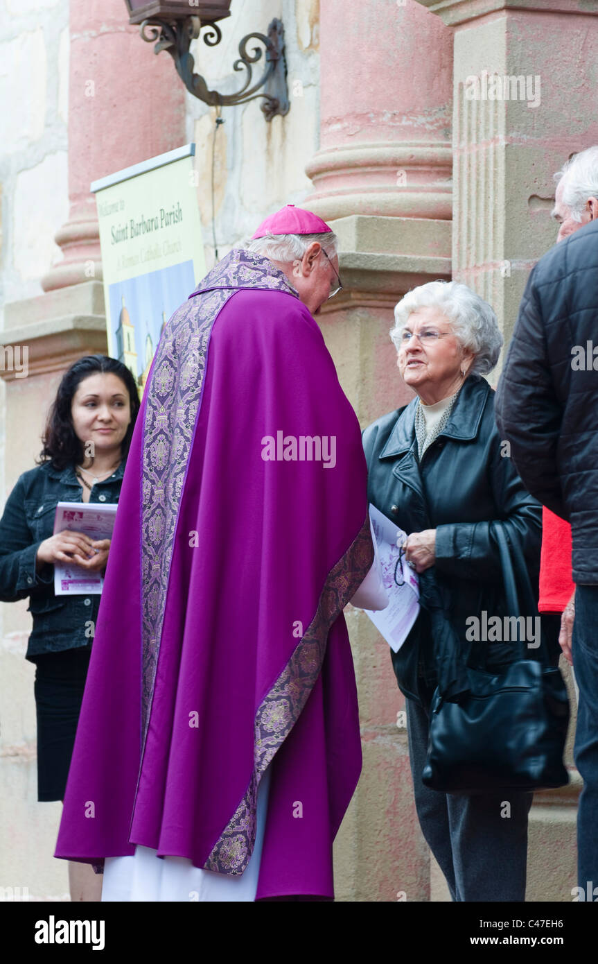Church catholic greeting stock photos church catholic greeting catholic priest greeting the congregation at the end of a church mass stock image m4hsunfo