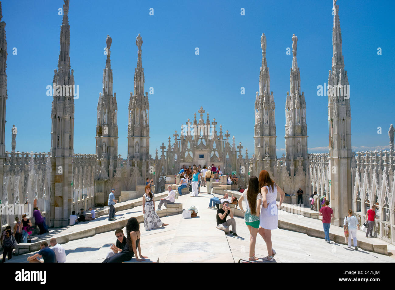 Tourists on the roof of Milano Duomo cathedral. - Stock Image