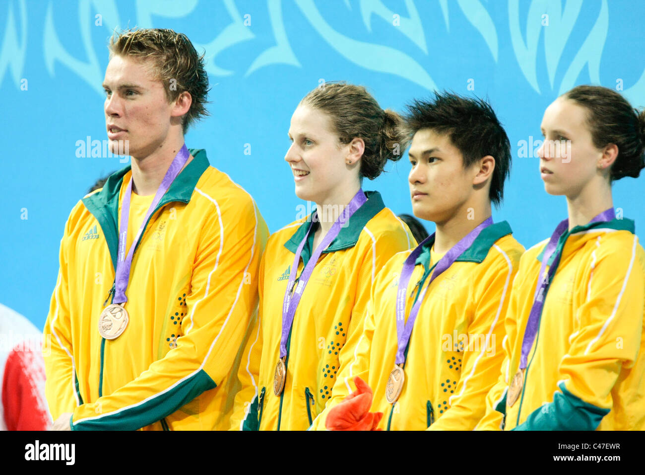 Team Australia takes the bronze in the Mixed 4x100m Medley Relay Finals. - Stock Image