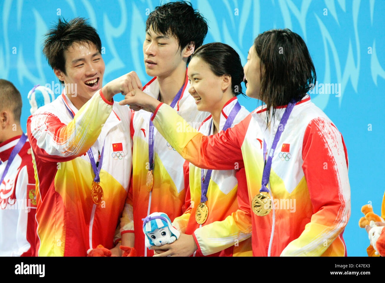 Team China takes the gold in the Mixed 4x100m Medley Relay Finals. - Stock Image