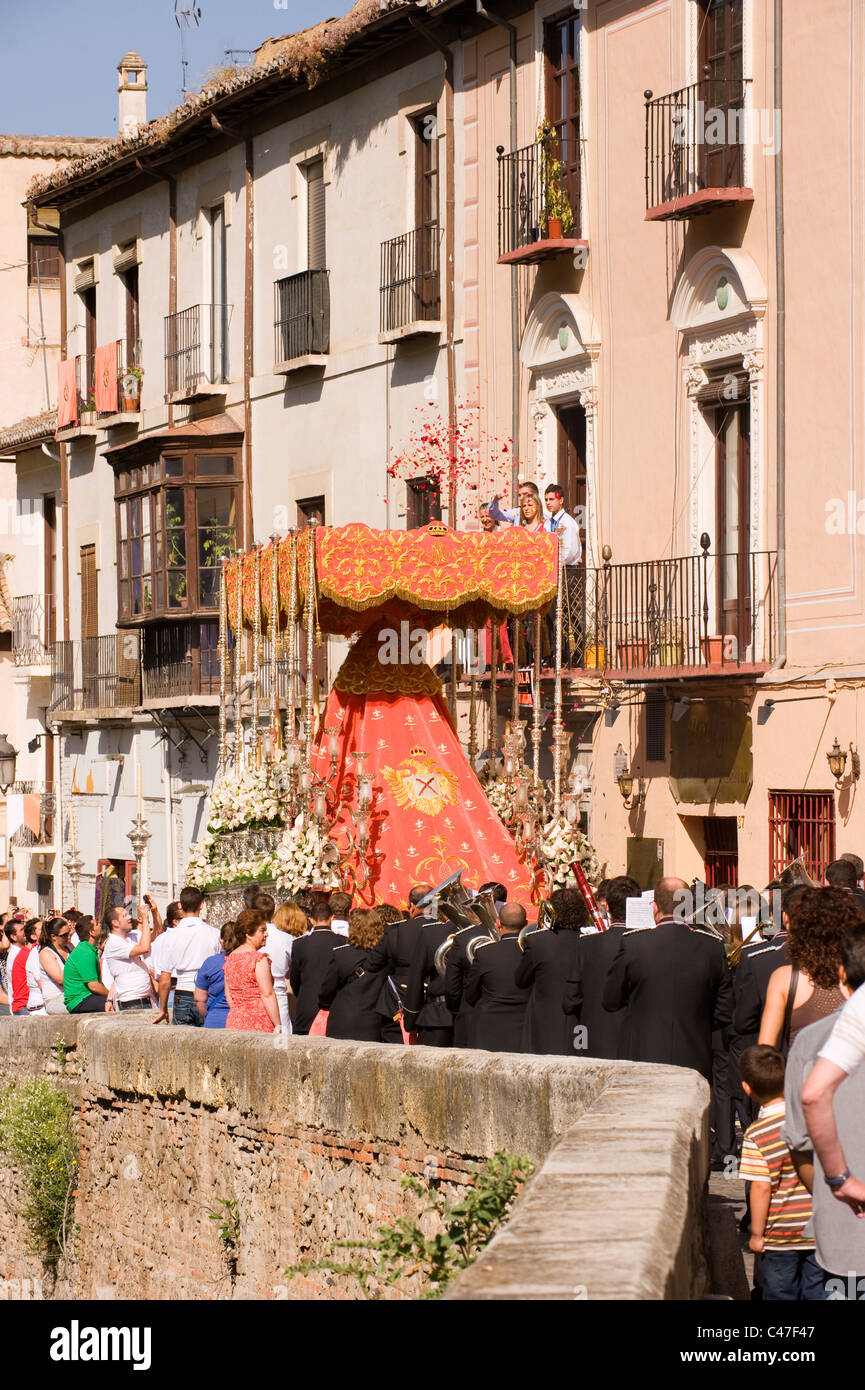 A traditional religious parade along a narrow street in Granada Andalucia Spain - Stock Image