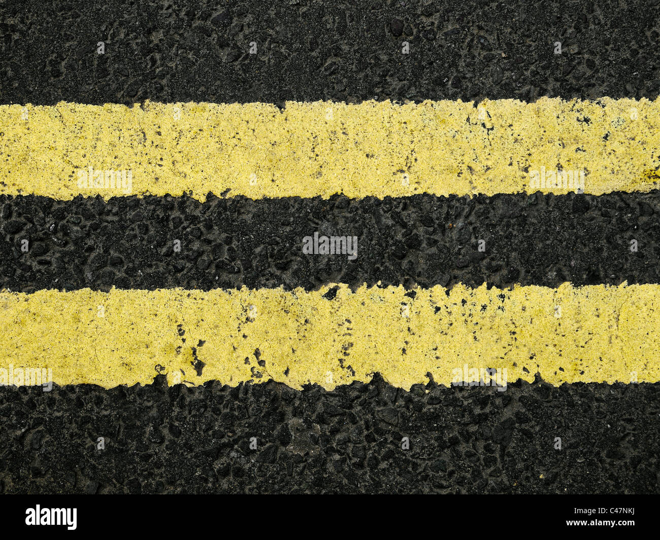 Double Yellow Line on a Road, Close Up. - Stock Image