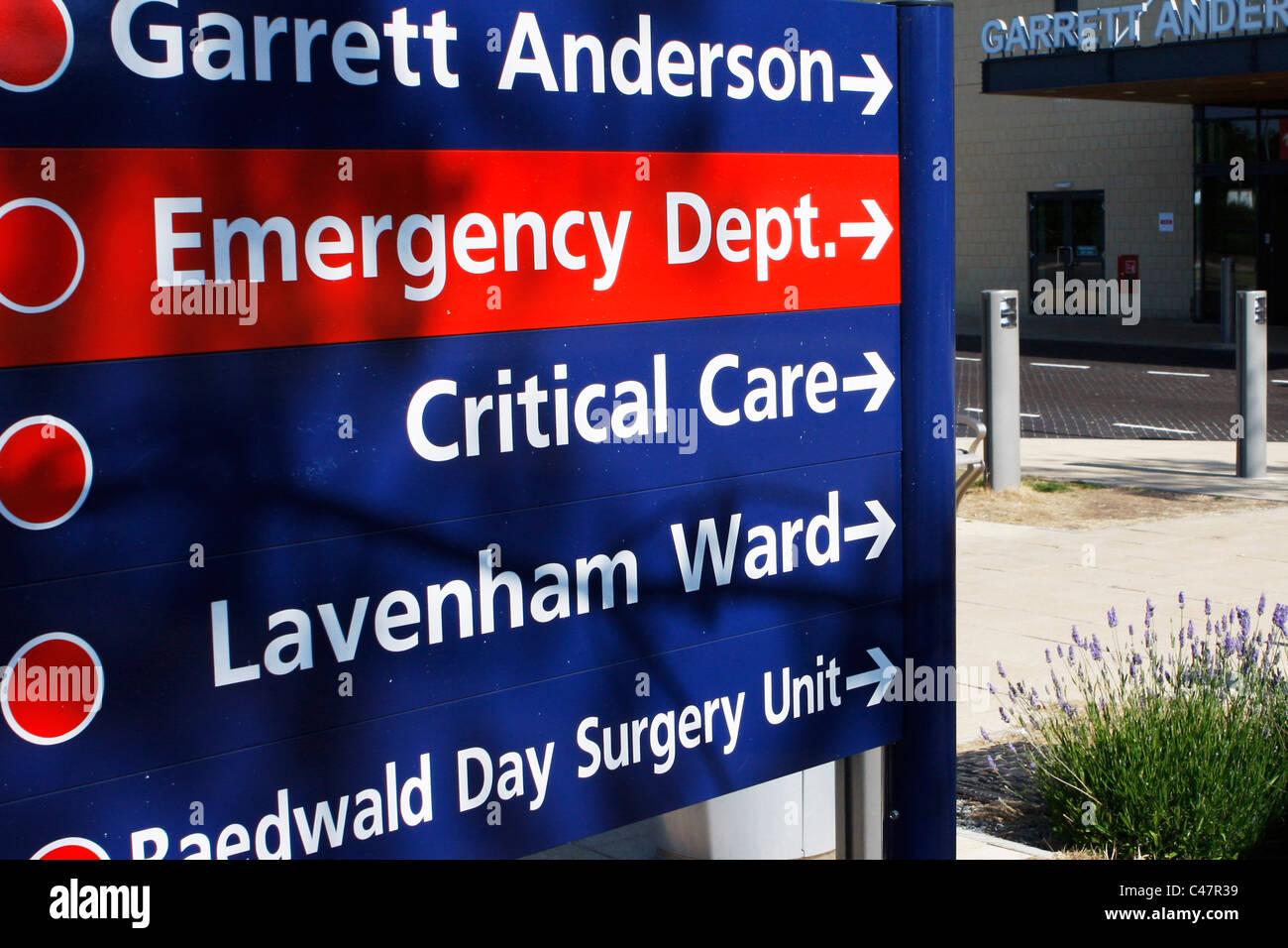 NHS Hospital Signage outside busy UK hospital, including Emergency Dept  sign - Stock Image