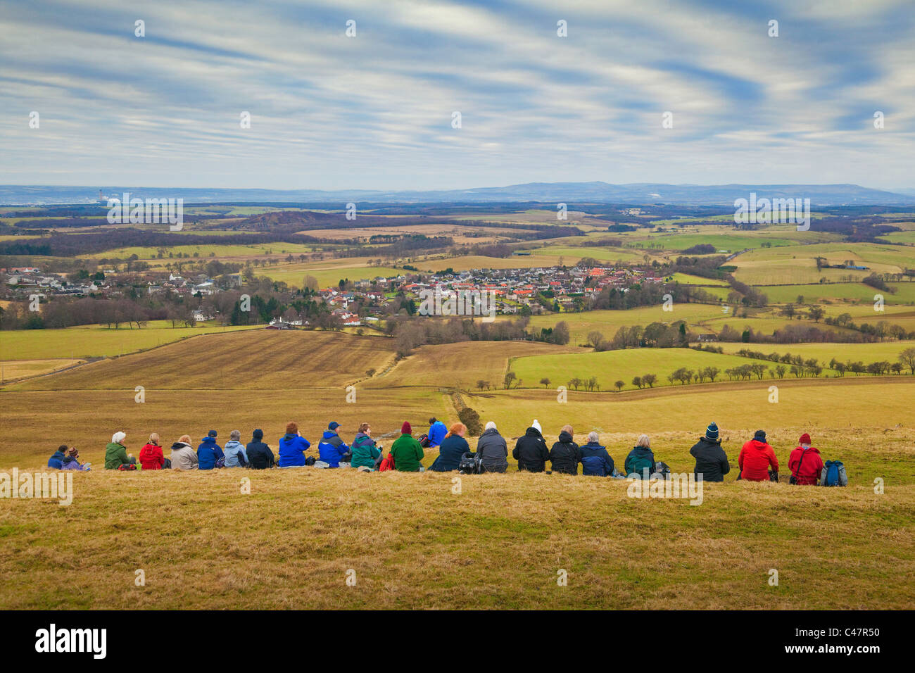 A Rambling Club on Saline Hill overlooking the village of Saline - Stock Image