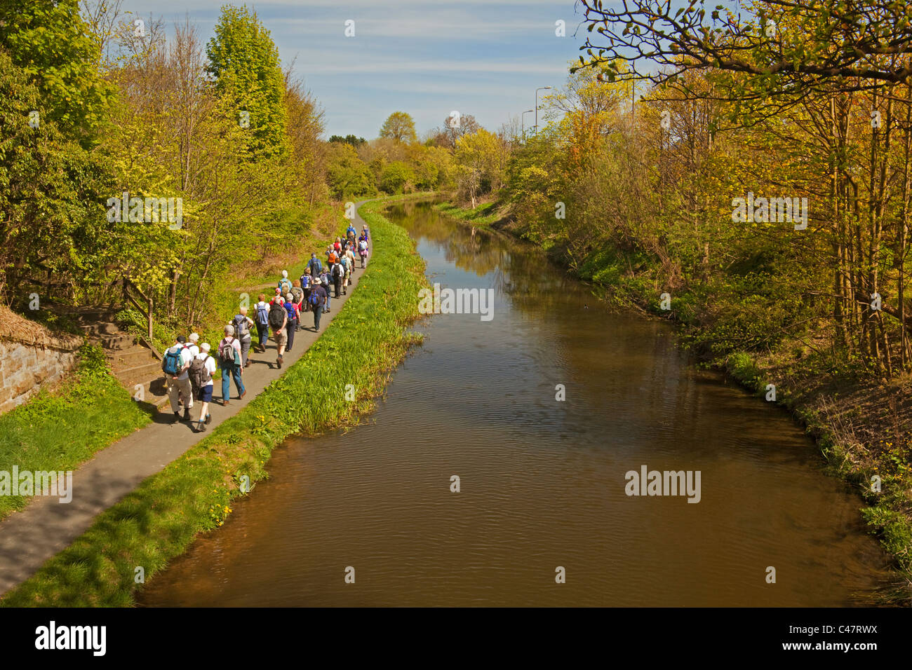 A Rambling Club walking along the Union Canal at Slateford - Stock Image