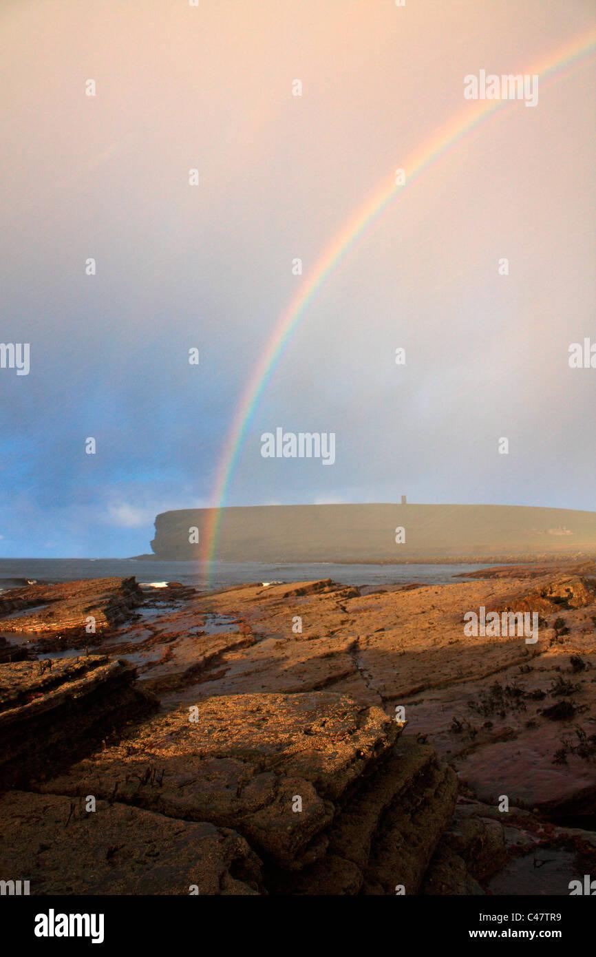 Orkney, Marwick Head with rainbow - Stock Image