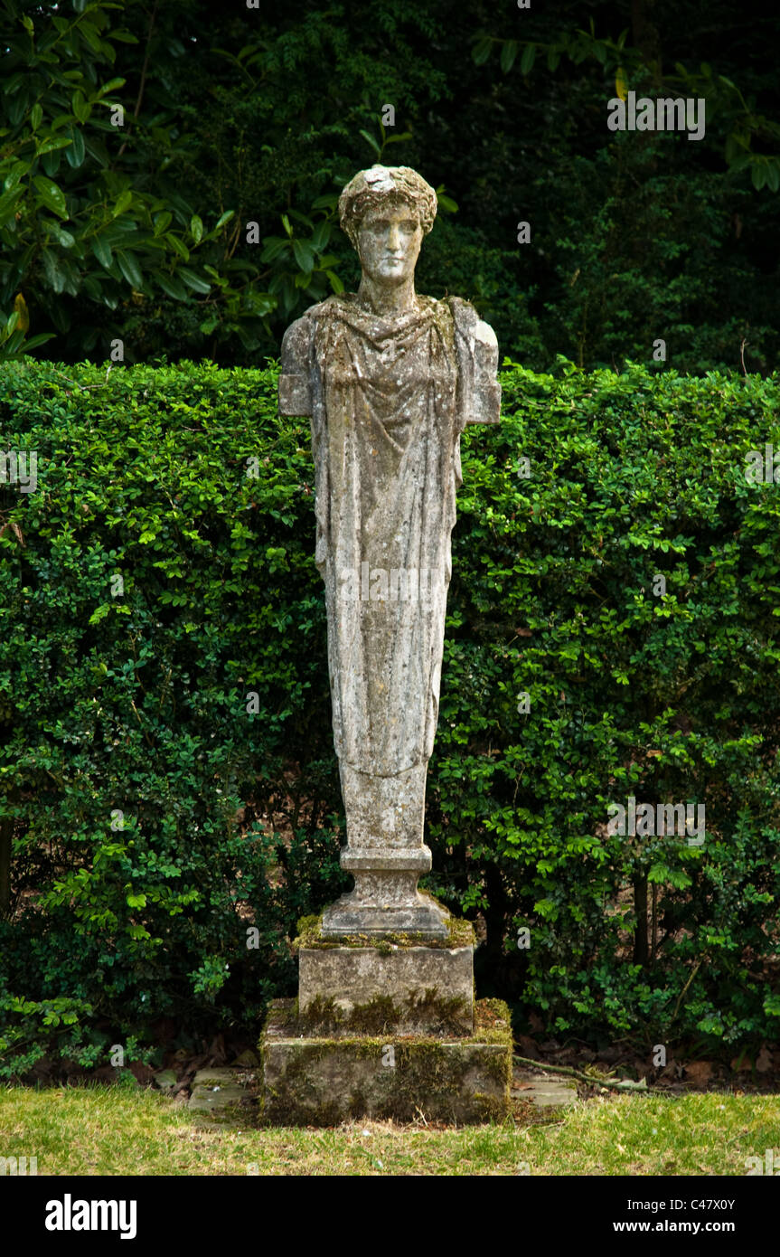 Classical statue against Yew Hedging and Laurel background. - Stock Image