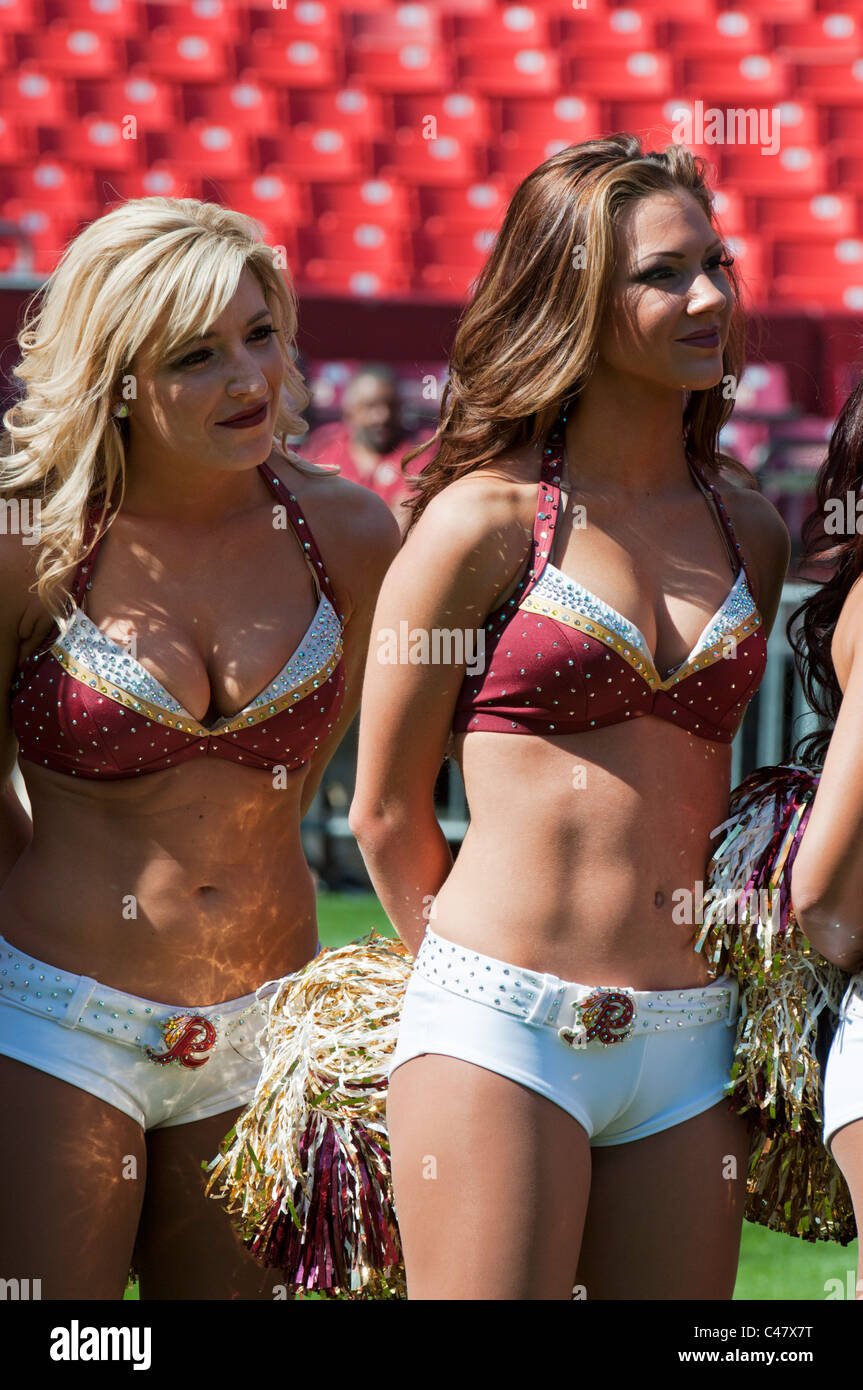 Two Washington Redskin NFL football team cheerleaders, 'The Redskinettes' at FedEx Field in Landover Maryland. - Stock Image