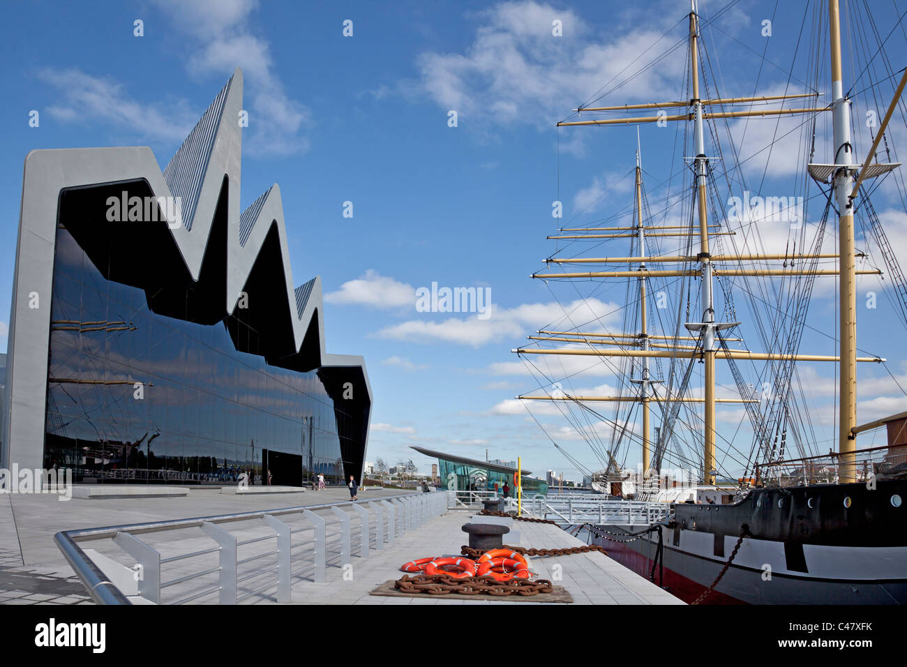 The Riverside Museum (Transport Museum) exterior and the Tall Ship (Glenlee) at Pointhouse Quay in Glasgow Harbour. - Stock Image