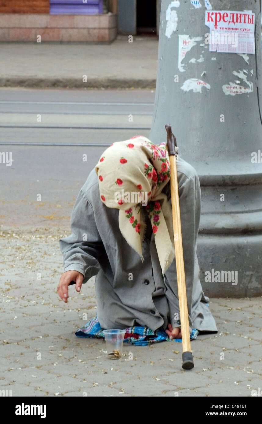 An old woman begging alms in the street Stock Photo