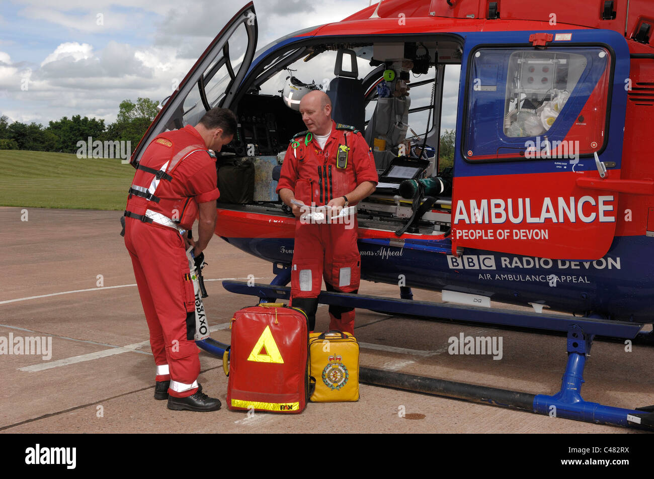 Devon Air Ambulance crew checking kit in Helicopter. Exeter Devon - Stock Image