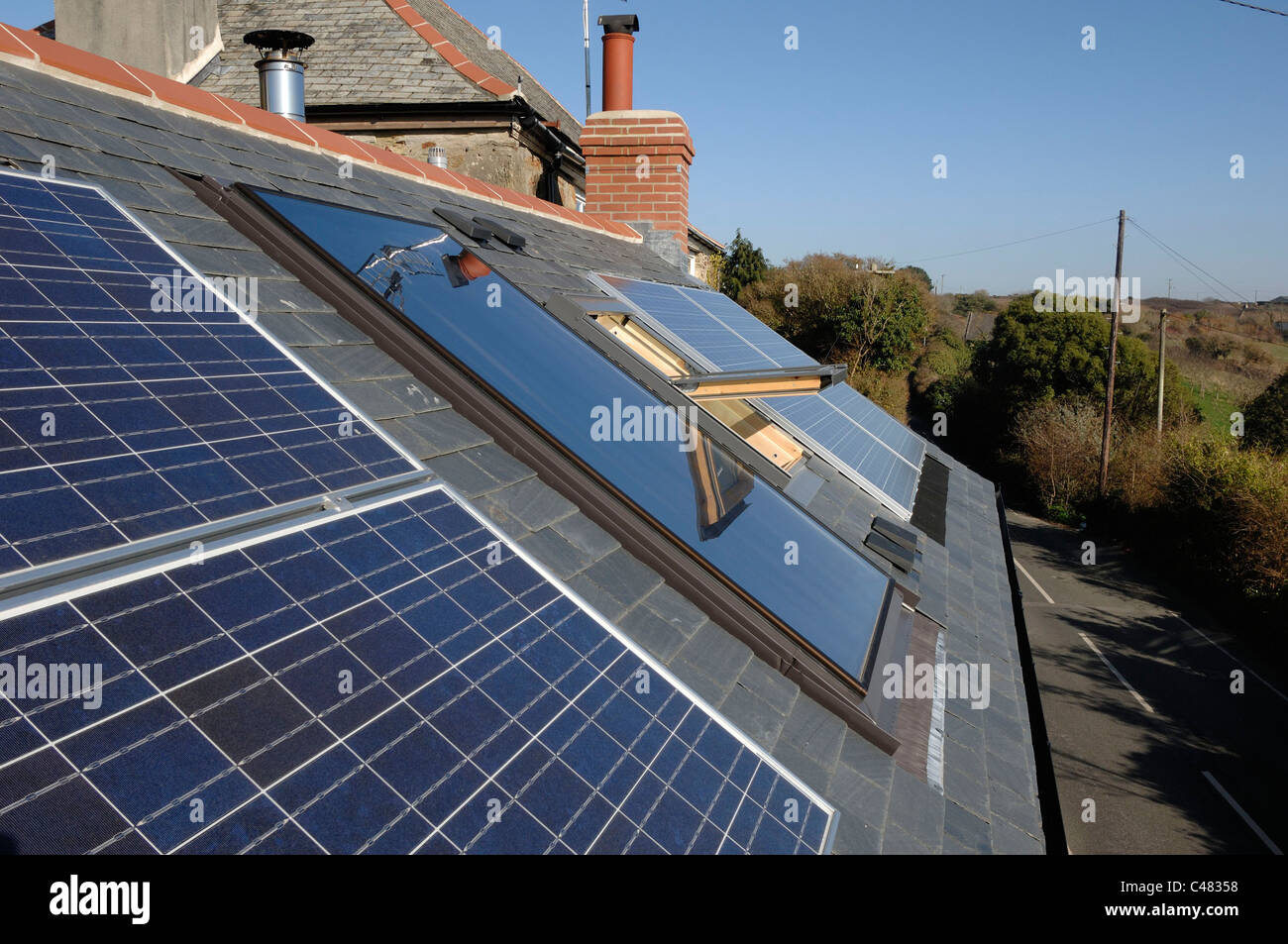 Photo voltaic cells installed on a private house in Cornwall England - Stock Image