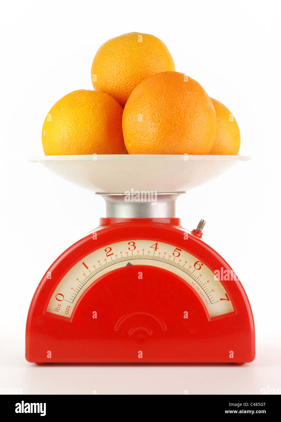 oranges on a vintage kitchen scale - Stock Image