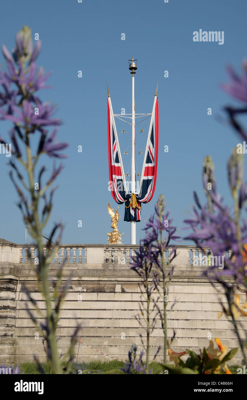 Ceremonial Union flags flying above The Mall near Buckingham Palace before the Royal Wedding, April 2011. - Stock Image