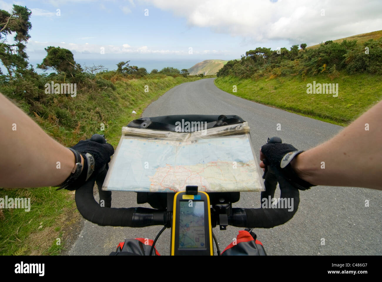 A GPS and map on a bicycle tour along the coast of Exmoor near hunters inn, Devon - Stock Image