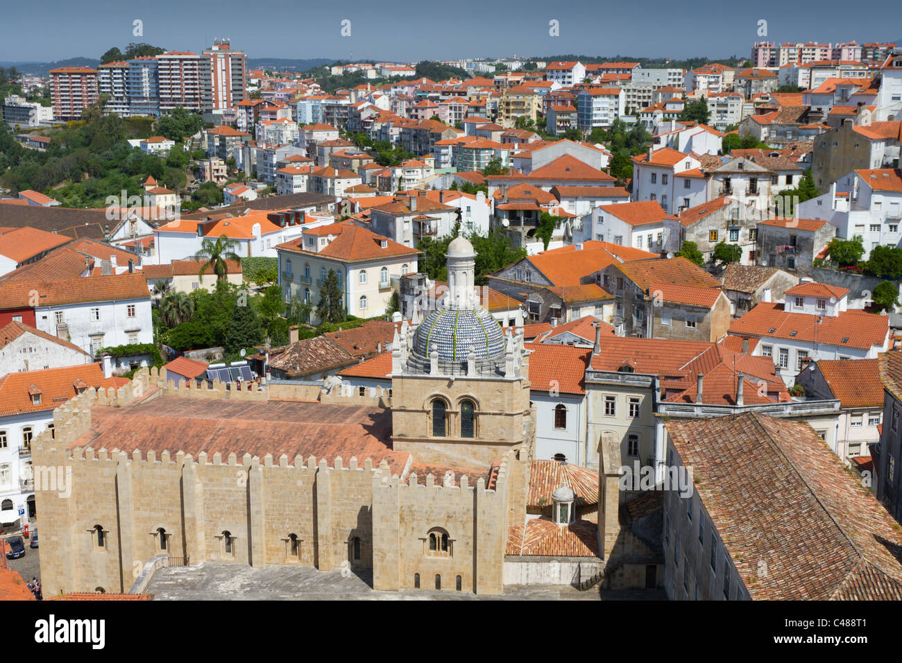 cityscape over the roofs of Coimbra with mighty cathedral se velha de Coimbra, Portugal Stock Photo