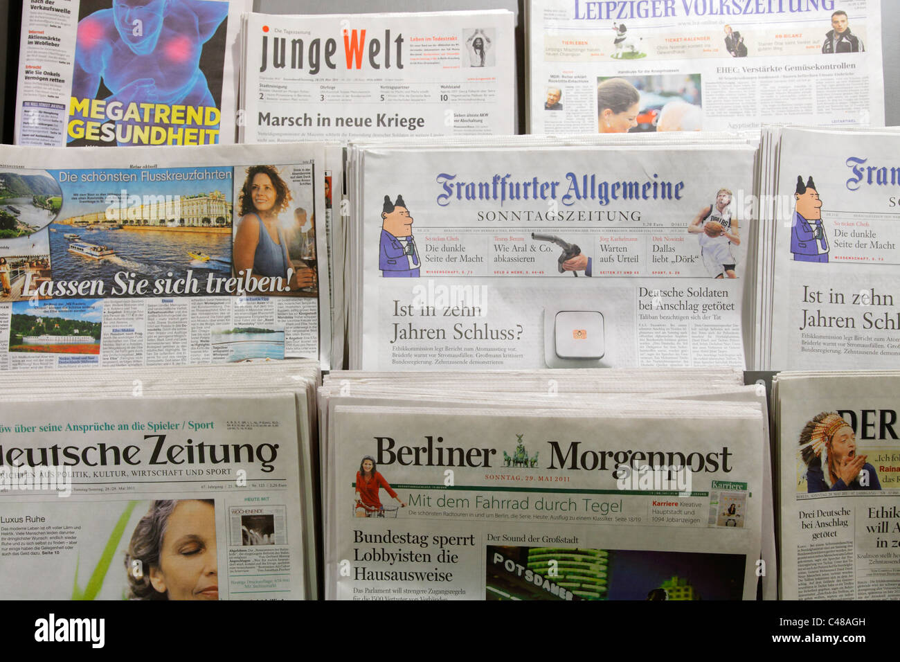 newspapers shelf - Stock Image