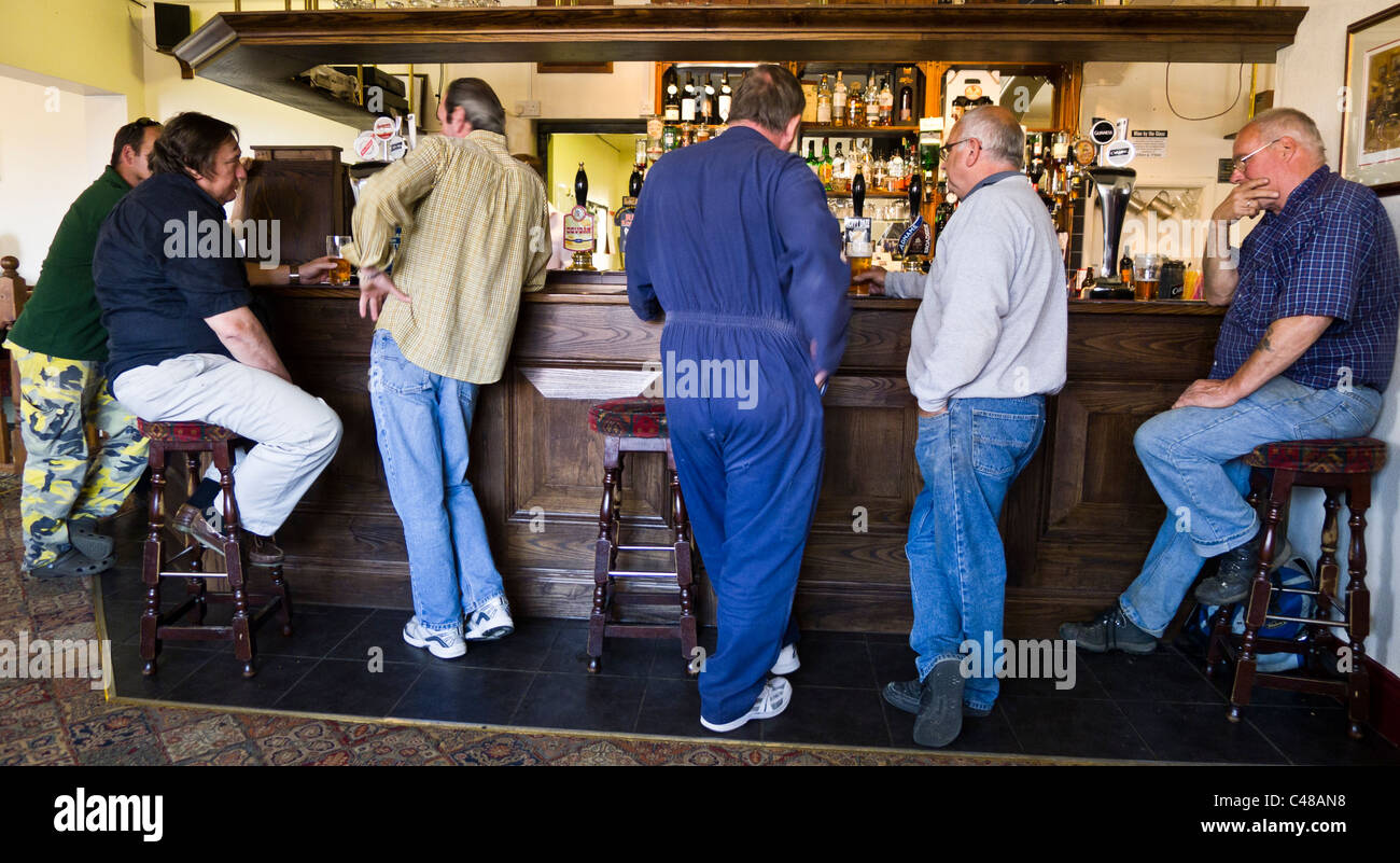 Group Of Middle Aged Men Standing At The Bar Of A Public