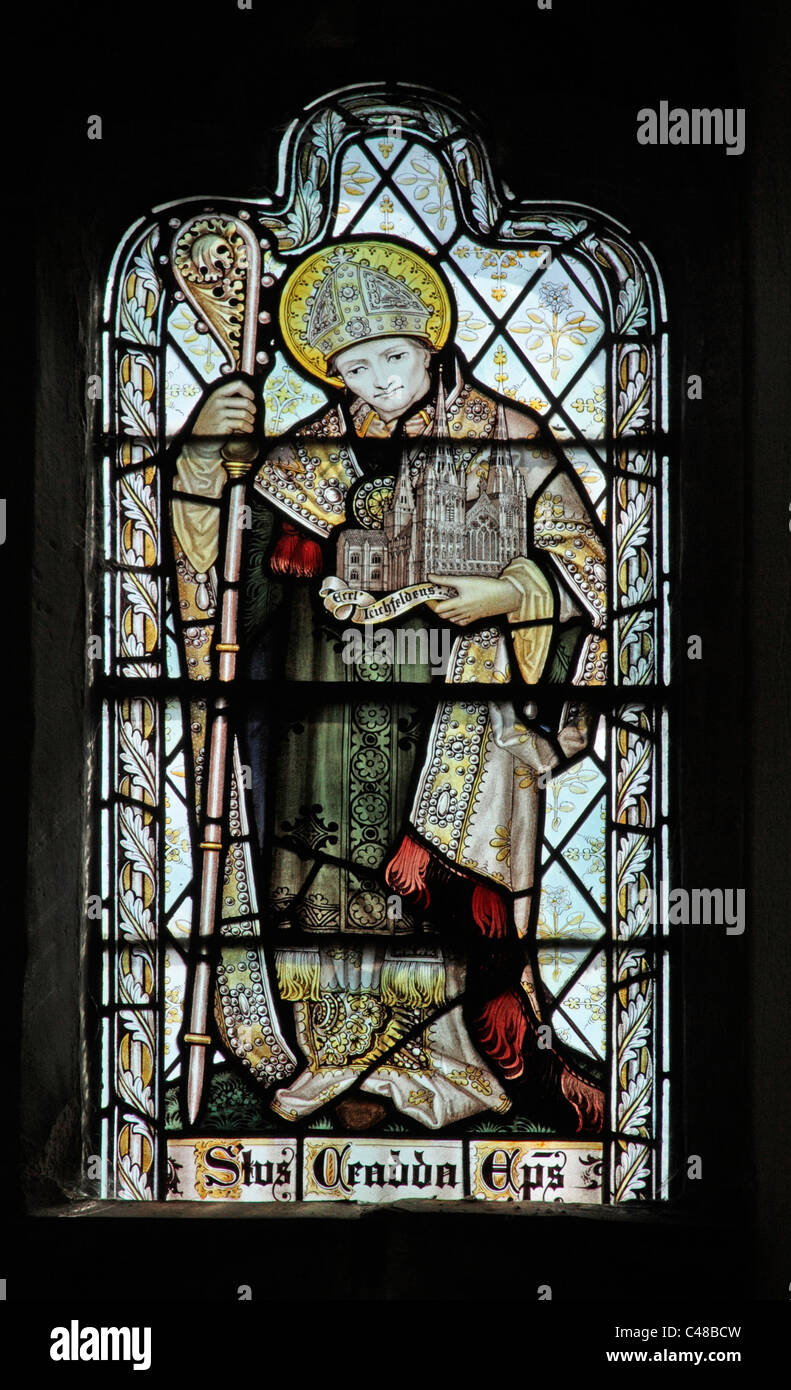 A stained glass window by The Kempe Studios depicting Saint Chad or Ceadda - Stock Image